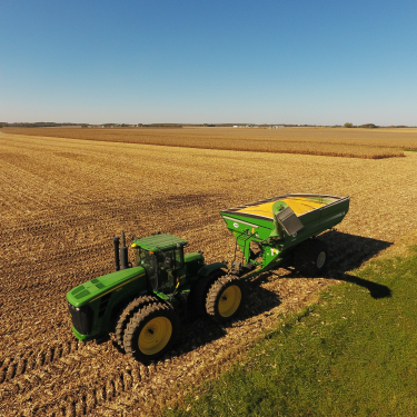 john deere tractor in harvested field